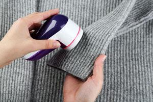 Cómo eliminar la pelusa o pelotitas de la ropa